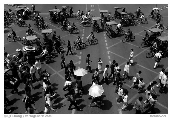 Pedestrians and bicyclists cross a major avenue. Chengdu, Sichuan, China