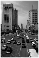 Car traffic on a major avenue. Chengdu, Sichuan, China ( black and white)