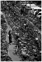 Woman walking in a bicycle parking lot. Chengdu, Sichuan, China ( black and white)