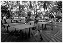 Playing table tennis, Liuha Park. Guangzhou, Guangdong, China (black and white)