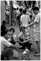 Peddling birds on the street. Guangzhou, Guangdong, China ( black and white)