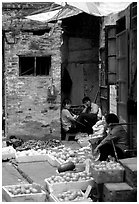Fruit vendors in a narrow alley. Guangzhou, Guangdong, China ( black and white)