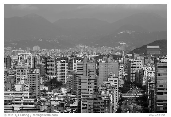 Old town center with jetliner and Grand Hotel in distance. Taipei, Taiwan (black and white)