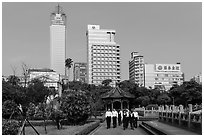 Office workers, 2-28 Peace Park, and high rises. Taipei, Taiwan (black and white)