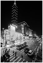 Shopping district street at night and Taipei 101. Taipei, Taiwan ( black and white)