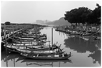 Small boat harbor along Damshui River. Taipei, Taiwan (black and white)