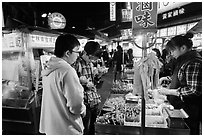 Customer buying foods at Shilin Night Market. Taipei, Taiwan (black and white)