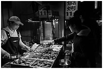 Taiwanese food specialties, Shilin Night Market. Taipei, Taiwan (black and white)