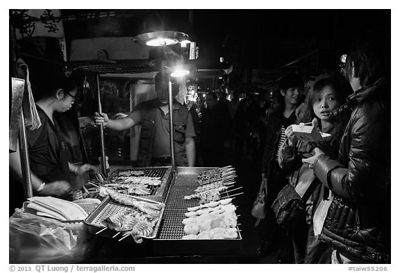 Sampling snacks at Shilin Night Market. Taipei, Taiwan (black and white)