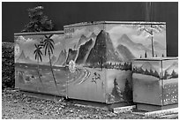 Decorated electric utilities boxes and wall. Taipei, Taiwan (black and white)
