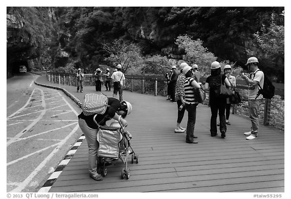 Tourists wearing park-provided helmets for safety. Taroko National Park, Taiwan (black and white)