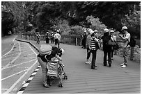 Visitors wearing park-provided helmets for safety. Taroko National Park, Taiwan (black and white)