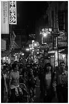 People on main street at night, Shueishe Village. Sun Moon Lake, Taiwan (black and white)