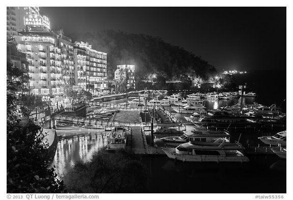 Harbor and waterfront at night, Shueishe Village. Sun Moon Lake, Taiwan (black and white)