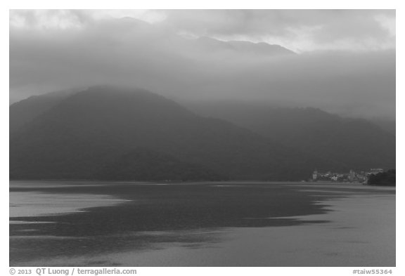 Itashao Village and cloud-shrounded mountains at dawn. Sun Moon Lake, Taiwan (black and white)
