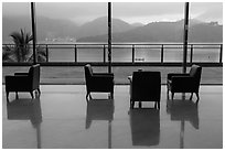 Chairs in hotel lobby with view of lake. Sun Moon Lake, Taiwan (black and white)