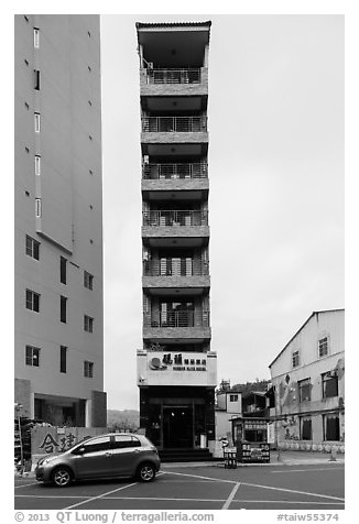 Tall and thin hotel building. Sun Moon Lake, Taiwan (black and white)