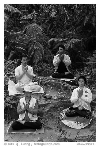 Members of religious sect in meditation. Sun Moon Lake, Taiwan (black and white)