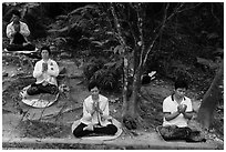 Group meditating in forest. Sun Moon Lake, Taiwan (black and white)