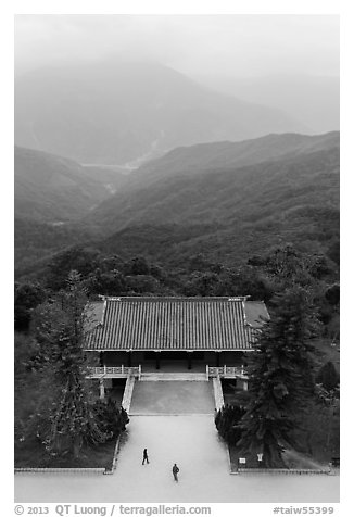 Two people, temple, and misty mountains, Tsen Pagoda. Sun Moon Lake, Taiwan (black and white)