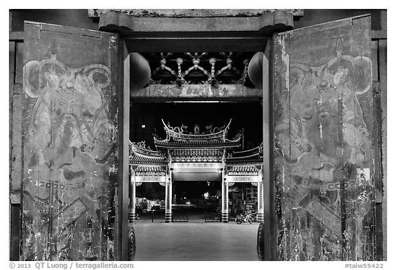 Painted doors, looking towards gate at night, Tienhou Temple. Lukang, Taiwan (black and white)