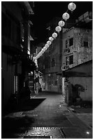 Red paper lanterns glowing in  Nine-turns lane at night. Lukang, Taiwan (black and white)