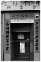 Purple doorway with red and yellow banners. Lukang, Taiwan ( black and white)