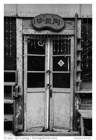Old door with paddlock. Lukang, Taiwan (black and white)