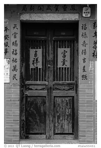 Wooden door with chinese writing on red paper. Lukang, Taiwan (black and white)