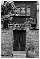 Brick wall and historic wooden house. Lukang, Taiwan (black and white)