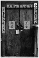 Wooden door traditional lock and chinese inscription on red paper. Lukang, Taiwan ( black and white)