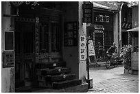 Man on bicycle amidst old houses in alley. Lukang, Taiwan ( black and white)