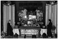 Main hall altar during buddhist service, Longshan Temple. Lukang, Taiwan (black and white)