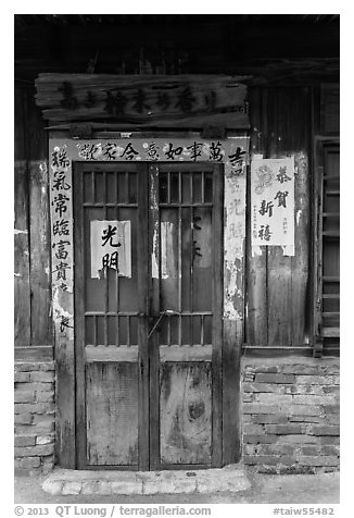 Door with weathered wood and inscriptions. Lukang, Taiwan (black and white)