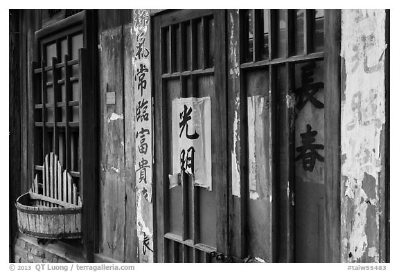 Weathered inscriptions on door. Lukang, Taiwan (black and white)