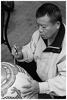 Man painting paper lantern. Lukang, Taiwan (black and white)