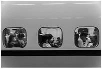 High speed rail car passengers seen through windows. Taiwan (black and white)
