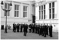Choir singing on the Burg. Bruges, Belgium (black and white)