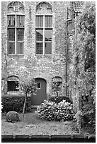 Brick house with small garden by the canal. Bruges, Belgium ( black and white)