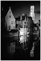 Old houses and belfry, Rozenhoedkaai, night. Bruges, Belgium (black and white)