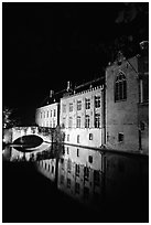 Houses and bridge reflected in canal at night. Bruges, Belgium ( black and white)