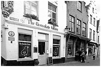 Street with chocolate shop. Bruges, Belgium ( black and white)