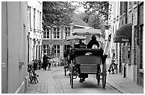 Horse carriage in a narrow street. Bruges, Belgium ( black and white)