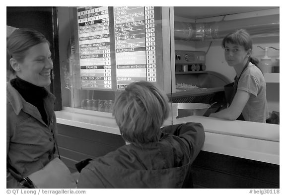 Women at a fries booth. Bruges, Belgium (black and white)