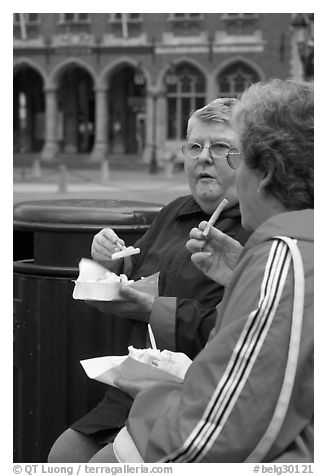Elderly women eating fries. Bruges, Belgium (black and white)