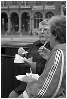 Elderly women eating fries. Bruges, Belgium ( black and white)