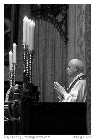 Priest in the the Basilica of Holy Blood. Bruges, Belgium (black and white)