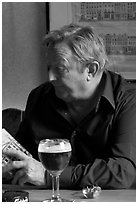 Man with book and beer. Brussels, Belgium ( black and white)
