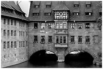 House built accross the river. Nurnberg, Bavaria, Germany (black and white)