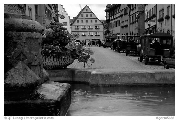 Fountain and street. Rothenburg ob der Tauber, Bavaria, Germany (black and white)